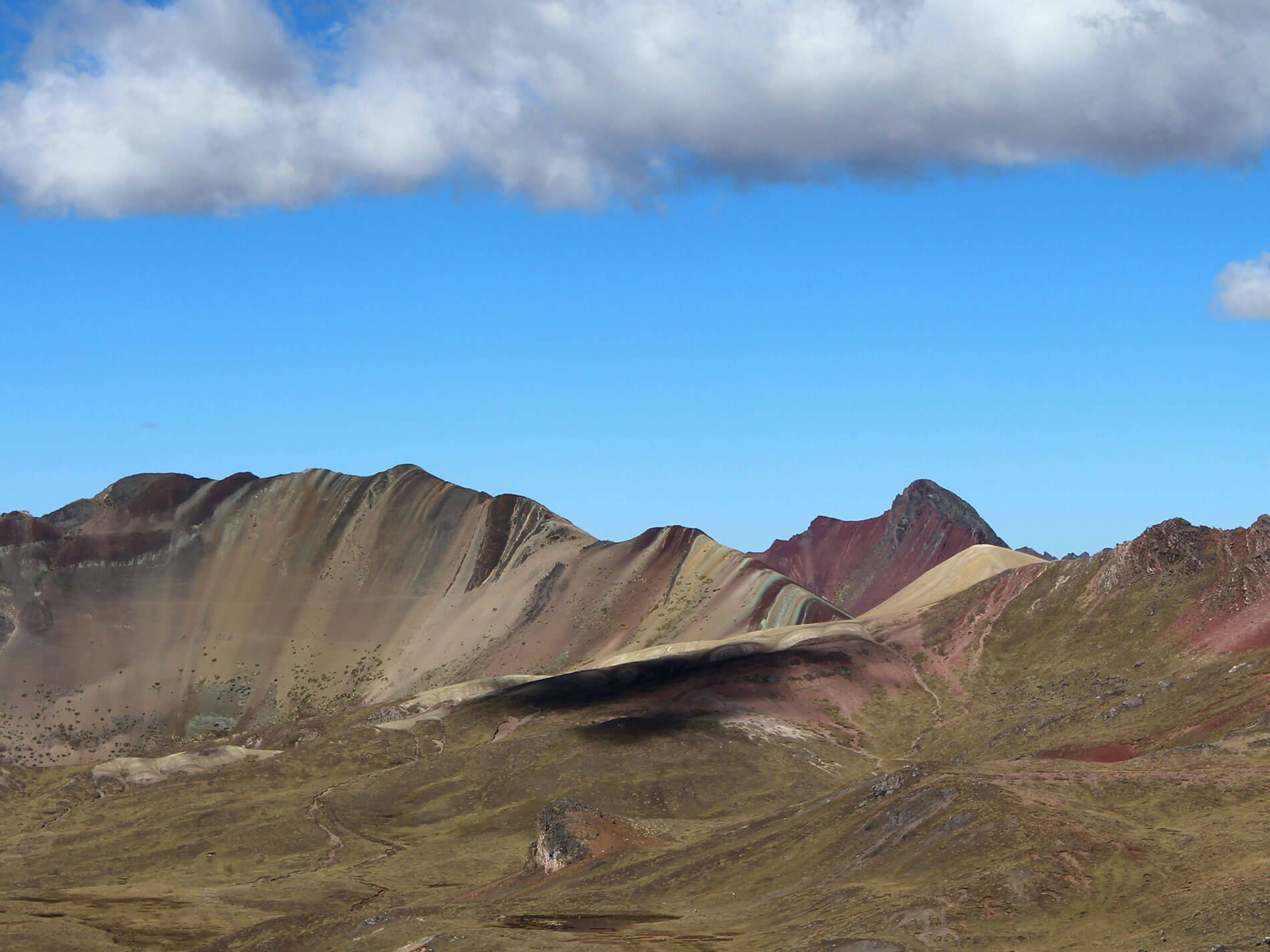 The view of Vinicunca Rainbow Mountain one hour before to arrive.